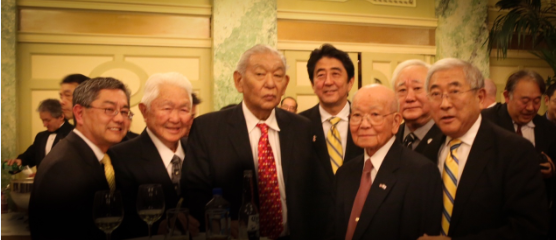 L-R:  Dr. Craig Uchida, former Chairman of the Board of the National Japanese American Memorial Foundation; Grant Ichikawa; Bob Nakamoto, immediate past president of JAVA; Prime Minister Abe; Terry Shima, Gerald Yamada, President of JAVA; and Floyd Mori, immediate past National Executive Director of JACL.  Photo by Bruce Hollywood.