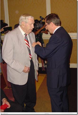 French Consul General (R) pins Legion d'Honneur on Forde Callis (L)
