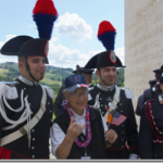 Roy Fujiwara, second from left, with Italian National Military Police (carabineri] officers in formal uniform to participate in the ceremony at the American cemetery in Florence, Italy.  Photo by Brian Yamamoto