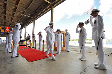 With Adm. Samuel Locklear III, commander of U.S. Pacific Command, right, looking on, Adm. Cecil D. Haney passes through the side boys after being relieved by Adm. Harry B. Harris Jr., commander of U.S. Pacific Fleet, right center, during a change of command ceremony on the Pearl Harbor waterfront, Oct. 16. (U.S. Navy Photo by Mass Communication Specialist Seaman Johans Chavarro)
