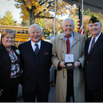 L-R.  Diane Gresse, Gerald Yamada, Jim McLaughlin (holding CGM replica), Gregory Laughlin at Memorial to Patriotism.  Photo by Bruce Hollywood.