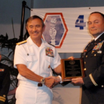 Admiral Harry Harris (center), JAVA life time member, presents the Courage, Honor, Patriotism Award to LTC Daniel Austin (right), Commanding Officer of 100, BN, 442nd Infantry.  LCDR Janelle Kuroda, USNR (left) read the  citation.  Photo by Harley Kudaishi.