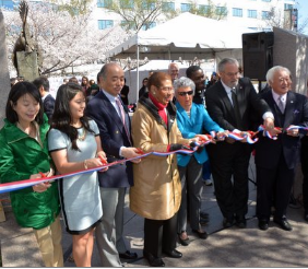 Mrs. Sasae, Amy Watanabe, MC, Ambassador Sasae, Congresswoman Norton , Jodie Bernstein, Dan Matthews, Gerald Yamada.