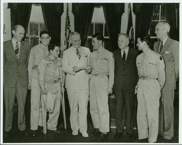 Kuwayama presenting President Truman with a check contributed by members of the 442nd for the Memorial to President Roosevelt.  September 11, 1945
