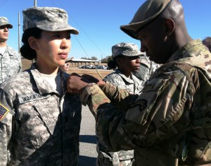 After completing 5 parachute jumps, Lt Col Kay Wakatake had her wings pinned on by Sergeant First Class Raymond Richardson, Senior Paralegal NCO, 75th Ranger Regiment, Fort Benning, GA.  (Photo by Captain Greg Peterson, 75th Ranger Regiment, Fort Benning, GA.)